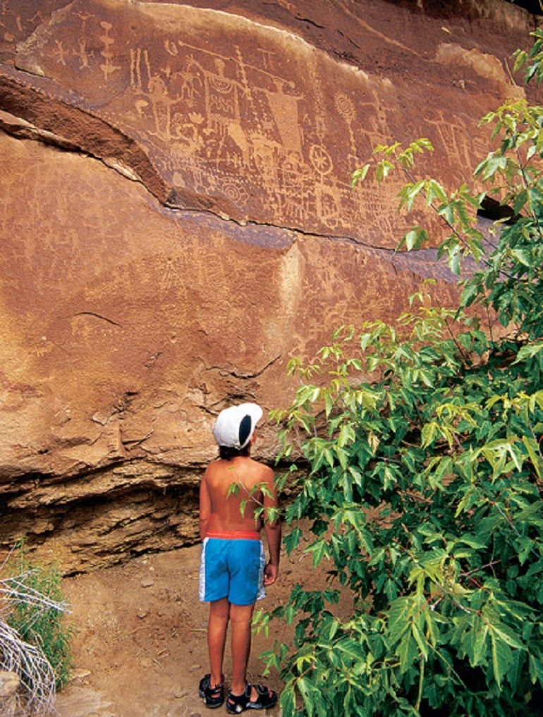 Image- Adventurous kids Discover Dinosaur Tracks and spectacular views of Native American Petroglyphs etched into rock on Potash Road-Adventure Travel