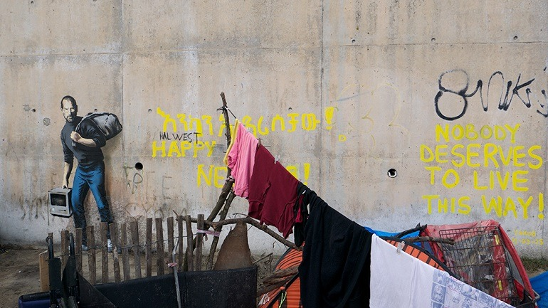 Image: Banksy graffiti commenting on the plight of Syrian refugees noting that 'Nobody deserves to live this way'