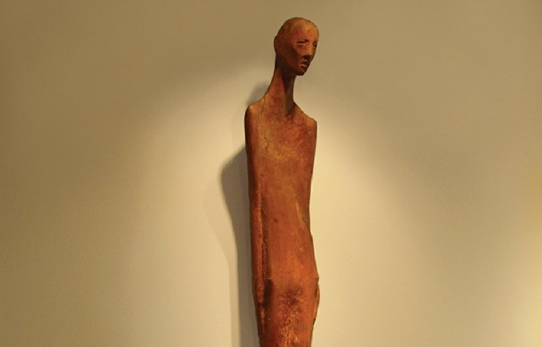 Image: Recovery, an Applewood figure sculpture by an Anonymous artist is in the collection of the American Visionary Art Museum