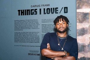 Image: Winner 7th Bombay Sapphire Artisan Series, Darius Frank, standing by the wall text of his exhibition 'Things I Loved' in Washington DC