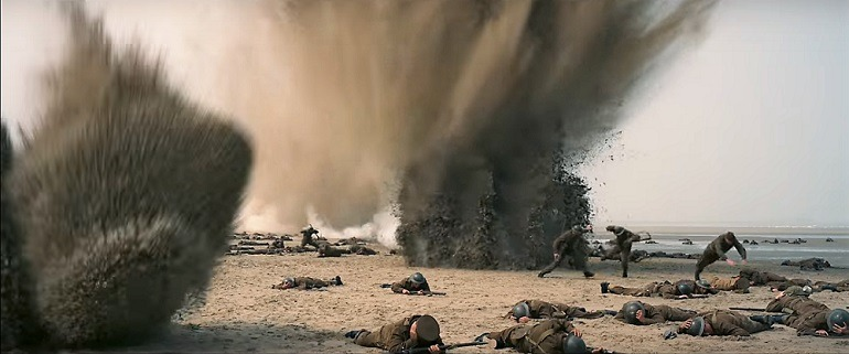 Image: Explosion at the beach sends soldiers diving in Dunkirk, a  film by  Christopher Nolan that  continues to gain tremendous popularity across the globe