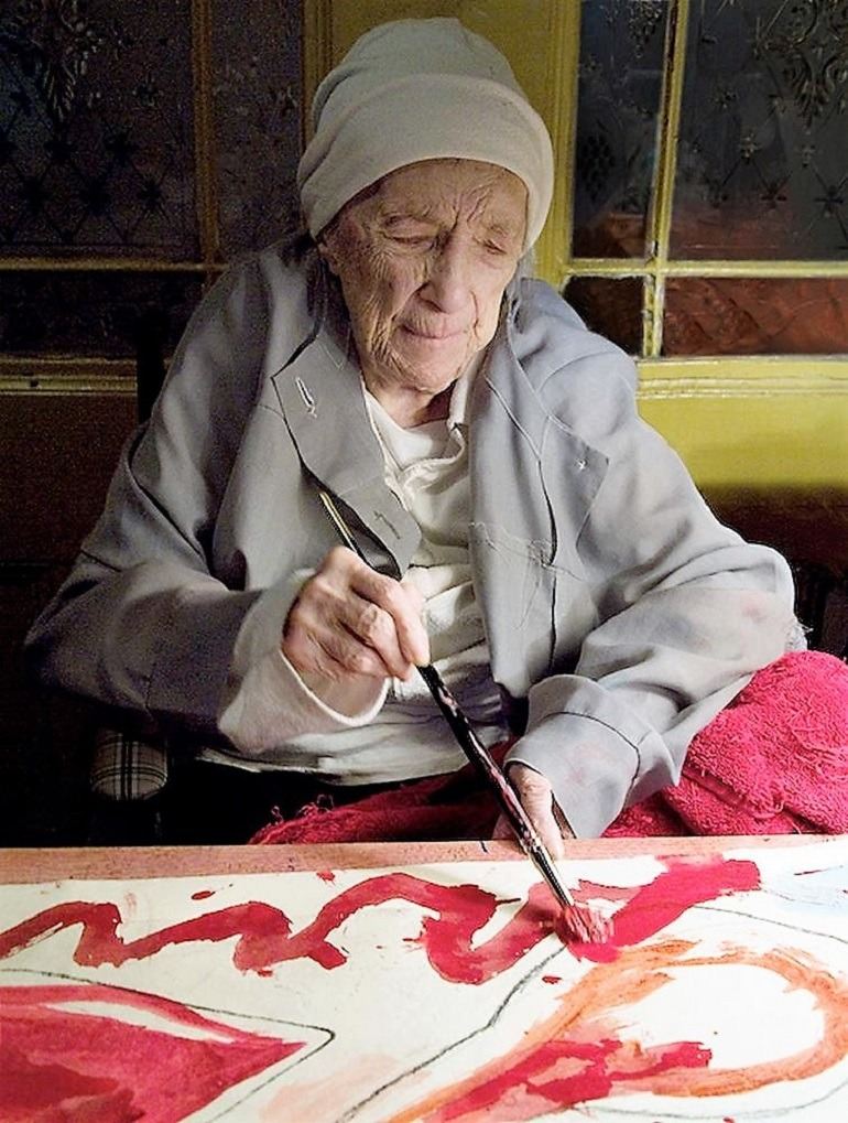 "Image: The French-American artist Louise Bourgeois working on her hand colored print ""La Famille"" in 2009"