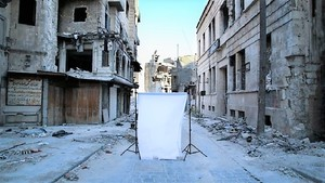 Image: A white canvas backdrop placed in the center of destruction marked the beginning of Iranian photographer Amir Kabir Jabbari's examination of the Syrian civil war and its impact on children